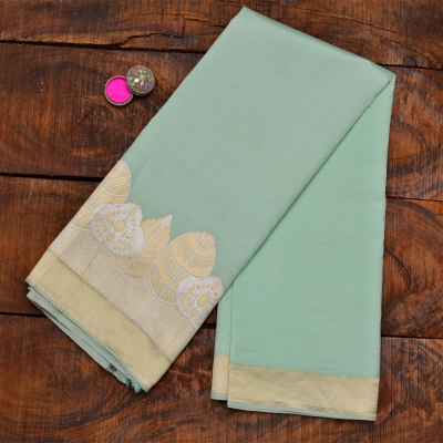 Subtle sea green handloom banarasi with statement border in matte gold and silver